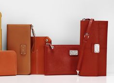 Tod's sunny hued leather wallets, passport holders and #iPad case.
