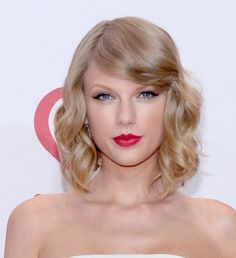 Taylor made a splash when she traded in her long curly locks for this fresh faced look. Pair it with a red lip and you have achieved classic style. | See more celebrity lobs here: http://www.mywedding.com/articles/14-celebrity-lob-hairstyles-for-weddings/?utm_source=pinterest&utm_medium=social&utm_campaign=fashion_style