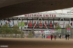 07-01 LONDON, ENGLAND - SEPTEMBER 24: People walk by the Aquatic... #domzale: 07-01 LONDON, ENGLAND - SEPTEMBER 24: People walk… #domzale
