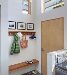 Hang a mantle next to the door and attach coat hooks. Place photographs or other sentimental items on it/above, and hang all of your outdoor gear on the hooks. A great way to maximize your space and free up another closet!