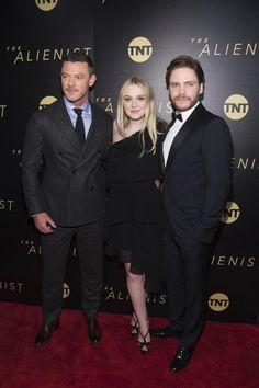 """Luke Evans, Dakota Fanning, and Daniel Bruhl attend """"The Alienist"""" in New York City on Jan. 16, 2018."""
