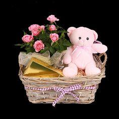 Preciosa canasta compuesta por peluche en rosa, plantita de rosal y una caja de…