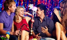 Groupon - Hookah and Two or Four Drinks at Bikini Cafe & Beer Garden (Up to 52% Off) in West Avenue. Groupon deal price: $11