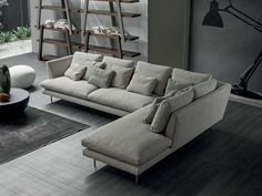 Lightness is the distinguishing feature of the Lars sofa: the armrests are tilt slightly outwards; the feet are made up of a slim metal line which give the sofa a suspended appearance; the cushions in two different sizes create movement and convey an idea of comfort and relaxation. Lars sofas Read More
