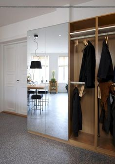 Wardrobe with open panels and mirrored panels.