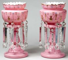 A pair of Bristol glass pink lustres having floral and gilt decoration and hung with drop prisms. England, circa 1801-1900