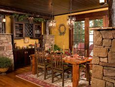 Whether you prefer the classic rustic cabin look or you're wanting to create a space with a more modern air, here are 27 beautiful log cabin interior design ideas to consider. Farmhouse Dining Room Table, Dining Room Wall Decor, Dining Room Design, Rustic Kitchen, Dining Area, Dining Rooms, Kitchen Dining, Warm Kitchen, Room Decor