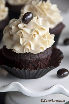 Dark Mocha Cakes with Bailey's Swiss Meringue Buttercream. Topped with a chocolate covered espresso bean.