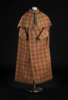 Woman's cloak with a cape, armholes, belt and standing collar, made of hard woollen cloth, woven with the Buchanan tartan: Scottish, about 1800 - 1820.