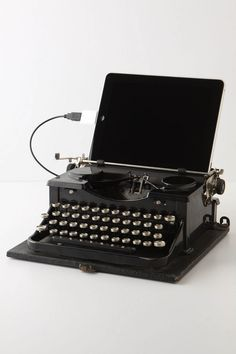 How COOL!!! A typewriter that can plug into an ipad... It can still be used as a regular typewriter too!