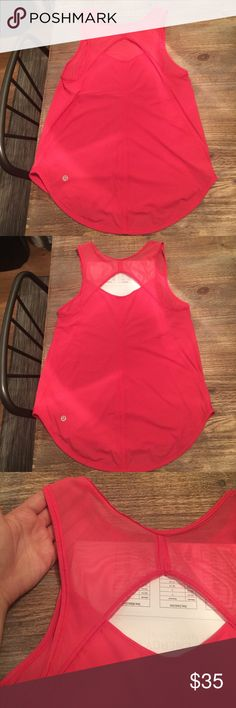 LULULEMON WORKOUT TANK with cutout in back *LULULEMON* hot pink workout tank. Cut out in the back, mesh on the back shoulders. Perfect condition, no stains or any funky gym smells 😜 lululemon athletica Tops Tank Tops