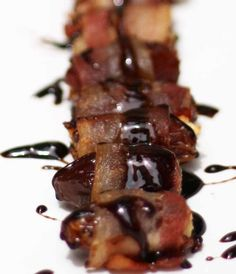 Bacon wrapped dates topped with a honey balsamic reduction - fancy finger food! | honeyandbirch.com