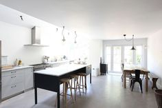 Colors, light and dark on island.  Brass facet, marble.  Lorn Road English Kitchen from Light Locations | Remodelista