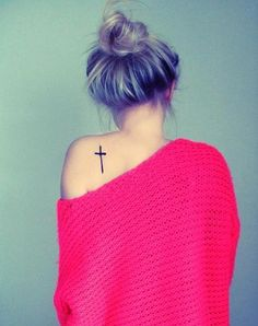 Her tat, her hair, and her sweater!