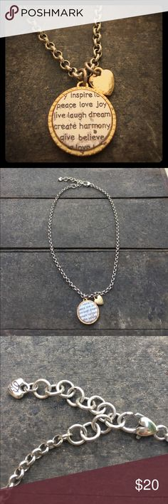 """Brighton Necklace Charm is silver with gold trim and reads """"inspire, peace, joy, love, live, laugh, dream, create, harmony, give, believe"""". Heart ❤️ clasp allows for adjustable length. Brighton Jewelry Necklaces"""