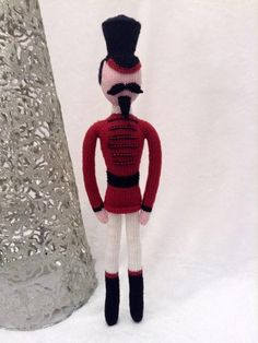The Nutcracker, a beautiful hand carved gift from Clara's Godfather – the magician and toymaker Drosselmeyer – is accidentally broken whilst the children play. Clara is devastated!When the party is over and the guests gone, Clara creeps quietly back to the Christmas tree and finds her beloved Nutcracker. She takes a ribbon from her dress to use as a bandage with which she mends her broken toy. Suddenly the clock chimes midnight and the Nutcracker begins to grow... The Nutcracker is a seam...