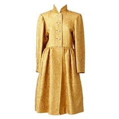 Yves Saint Laurent Gold Brocade Evening Coat and Skirt Ensemble. | From a collection of rare vintage suits, outfits and ensembles at http://www.1stdibs.com/fashion/clothing/suits-outfits-ensembles/