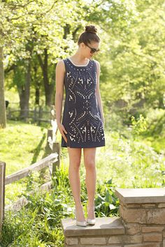 Adorable navy sheath dress with fun cutout detailing