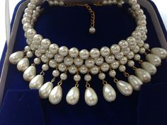 Material list :- ---------------------------- white big beads -- 10 mm - 77 white small -- 7mm - 22 pear shaped pearl -- 12x8mm - 15 golden beads -- 1mm - 49...