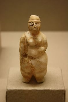 Calcite, 7th millennium B.C.E., From Mesopotamia  The female figure was of great symbolic significance during the Neolithic period, as attested by a proliferation of figurines in a variety of materials, here including stone, lime plaster, and clay. Although we cannot be certain whether these figures represent humans or deities, some scholars have identified them as representations of a Mother Goddess, possibly linked to the importance of fertile land in agricultural societies.