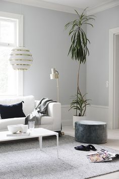 Beautiful white and light grey-blue sitting room in the Finnish home of Maija Rasila.
