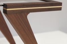 AVIATOR - Table made from mahogany (sapele) with maple inserts, oiled. dim.: 115 x 40 x 41 cm.                                                                             thickness of glass 8mm.