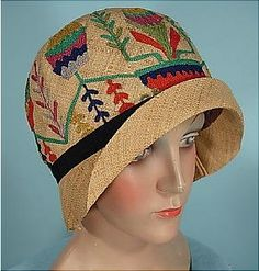 """ca. 1928 DAMACELLA  Natural Straw Cloche with Embroidered Colorful Yarn! Fully lined with original lining. As with many true antique cloches, it's a small size... they used to be called """"headache"""" size. It will JUST tightly squeeze onto a normal sized 22"""" head. Excellent condition."""