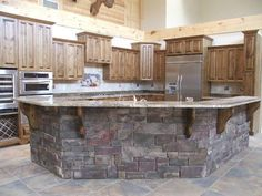 This layout is so similar to my kitchen...shape of bar and everything! totally want to resurface the wood bar with stone!!! Hmmm...definitely could do this
