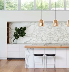 Modern kitchen: marble backsplash, wood countertop and copper pendants for island. Kitchen And Bath, New Kitchen, Kitchen Dining, Kitchen Decor, Marbel Kitchen, Kitchen Black, Copper Kitchen, Island Kitchen, Kitchen Shelves