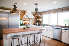 Chip and Joanna Gaines (Fixer Upper) completely transformed the kitchen with brick walls, black granite countertops, industrial pendants and a custom-built island. Fixer Upper Hgtv, Fixer Upper House, Fixer Upper Kitchen, New Kitchen, Kitchen Cousins, Kitchen Brick, Kitchen White, Awesome Kitchen, Modern Farmhouse Kitchens