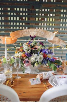 Banner - Add a touch of whimsy to your tablescape with a handwritten ribbon banner sign. {Gilded Lily Events}