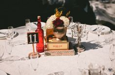 Cigar Box and succulent centerpieces | Fun shabby chic centerpiece with cigar boxes, red bottle, and a few ...