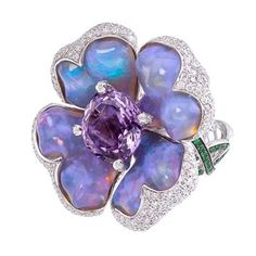 Exotic Lavender Blue carved Opal Flower Petals blossom around an Amethyst, Diamond micro pavé detail. Sparkling Green Tsavorite vine weaves .around the finger