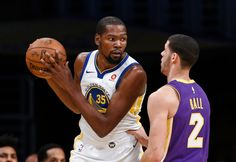 Golden State Warriors forward Kevin Durant, left, is defended by Los Angeles Lakers guard Lonzo Ball during the first half of an NBA basketball game Wednesday, Nov. 29, 2017, in Los Angeles. (AP Photo/Ringo H.W. Chiu)