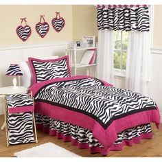 Give your little fashionista the room of her dreams with this fabulous zebra print bedding set from Sweet Jojo Designs. Bold colors and a lightweight, cozy comforter complete the look of this fashion-forward bedding set.