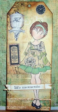 Julie Nutting stamp with Tim Holtz stamp and die cuts.