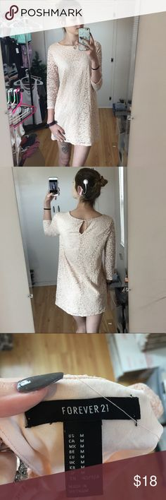 🦄 4/$12 C3 Forever 21 Long Sleeve Shift Dress Mod/retro style light pink dress with lace overlay. 3/4 sleeves with small buttoned keyhole on the back neckline. Lace and lining are both stretchy. Sleeves are unlined. Gently worn, has a couple of loose threads. Tag size medium, please refer to measurements provided.  Bust: 17.5 inches  Waist: 17 inches  Length: 31 inches  Smoke free/cat friendly home.  All measurements are taken while flat and are approximate. Forever 21 Dresses Mini