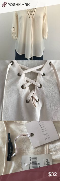 Blu Pepper Blouse •Cream color blouse with detailed buttons on sleeves •Round neckline with lace up detailing •Tie closure at neckline •3/4 sleeves •100% Polyester  •Hand wash on COLD! Brand NEW with Tags! Blu Pepper Tops Blouses