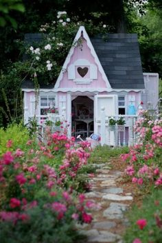tiny pink house with heart window