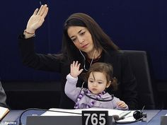 Licia Ronzulli's daughter gives her vote! Family friendly European Parliament where children can go to work with their parents. If only my toddler was as content to sit like that without the aid of the tv!