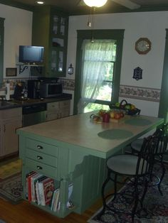 "Homemade Kitchen Island - Thinking of ""redoing"" my attached cabinet seating area to something like this"