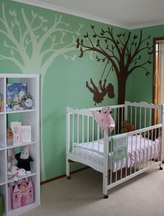 Liam and Katie Pratt used a fresh mint green on the wall behind the Silhouette Swing mural. Then they repeated a second tree in white to pick up the color of the crib and furniture. Beautiful job!