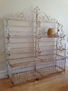 The most beautiful hand-wrought french baker's rack ever, early 1800's with original ironworker's label. For Sale at www.heirloomestatesonline.com