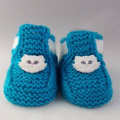Knitted baby booties - The Cheshire Cat