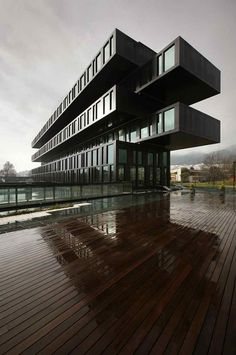The exterior of the Axis Viana Hotel in Viana do Castelo, Portugal is made up of reflective aluminum, black glass, and green stone. (Courtesy Axis Viana Hotel) From: The Hotel World's Most Striking Architecture. Cantilever Architecture, Hotel Architecture, Contemporary Architecture, Architecture Design, Black Architecture, Contemporary Building, Amazing Architecture, Hotel Portugal, Resorts