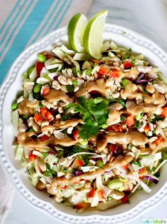 This Thai Chicken Salad with Peanut Dressing is full of satisfying crunchy veggies, and topped with a sweet & tangy peanut dressing.
