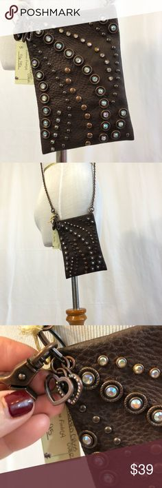 🔥NEW!🔥Jeweled and Studded Crossbody This darling bag has so many pretty and functional details. The stud design is a standout, the chain and metalwork is a pretty bronze to match the bag. Also includes an ID money holder. Fits an iPhone 8 Plus. No trades or insulting offers please. Thanks for looking! Bags Crossbody Bags