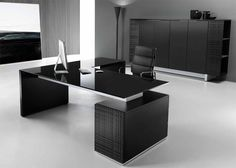 Choose an all black design to create a sleek and stylish atmosphere in your office. Black glass desk tops with matt black lacquered structures.