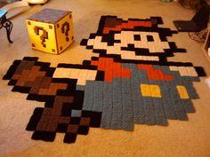 Crochet Mario rug! (I love the idea of using granny squares to make a mosaic.)