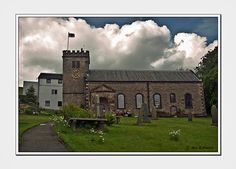 Newchurch-in-Pendle, this church has the 'eye of God' sculptured into the wall so that it could watch who was not attending church. Near the south wall (carved with a skull) is the alledged grave of Alice Nutter, one of the witches.